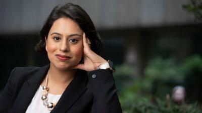 Sara Khan, smiling